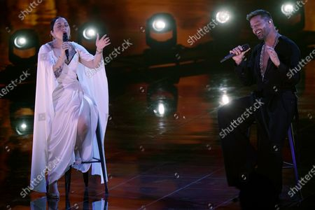 Stock Image of Carla Morrison, left, and Ricky Martin perform for the 21st Latin Grammy Awards, airing, at American Airlines Arena in Miami