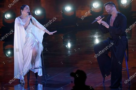 Carla Morrison, left, and Ricky Martin perform for the 21st Latin Grammy Awards, airing, at American Airlines Arena in Miami