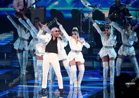 Stock Photo of Pitbull performs along with frontline workers as his band for the 21st Latin Grammy Awards, airing, at American Airlines Arena in Miami