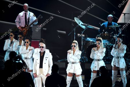 Pitbull performs along with frontline workers as his band for the 21st Latin Grammy Awards, airing, at American Airlines Arena in Miami
