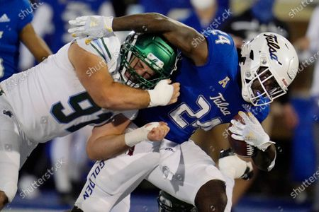 Tulane defensive end Noah Seiden (91) tackles Tulsa running back Corey Taylor II (24) during the first half of an NCAA college football game in Tulsa, Okla