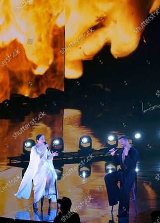 Stock Photo of Carla Morrison, left, and Ricky Martin perform for the 21st Latin Grammy Awards, airing, at American Airlines Arena in Miami