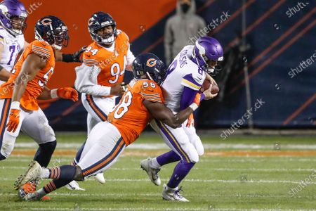 Stock Photo of Chicago Bears inside linebacker Roquan Smith (58) tackles Minnesota Vikings quarterback Kirk Cousins (8) during the second half of an NFL football game, in Chicago