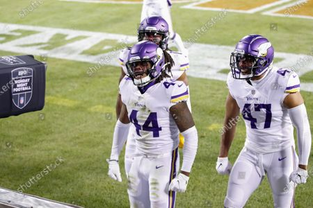 Stock Image of Minnesota Vikings safety Josh Metellus (44) celebrates with teammates after recovering a fumbled punt return by Chicago Bears' Dwayne Harris during the second half of an NFL football game, in Chicago