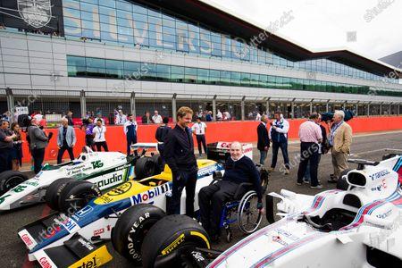 Williams 40 Event Silverstone, Northants, UK Friday 2 June 2017. Sir Frank Williams joins Nico Rosberg admiring a Williams FW08, FW11 and a Williams FW40 Mercedes on the grid.  World Copyright: Sam Bloxham/LAT Images