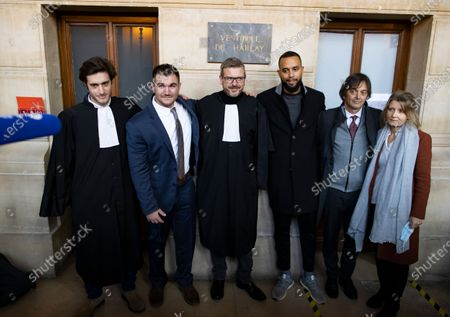 (2-L-R) US citizen Alek Skarlatos, French lawyer Thibault de Montbrial, US citizen Anthony Sadler and Franco-American Mark Moogalian and his wife Isabelle pose  for a picture outside the court room during  the fifth day of the  Thalys attack trial, in Paris, France, 20 November 2020. On 21 August 2015, gunman Ayoub El-Khazzani opened fire with an assault rifle, shot and wounded three people on a Thalys train travelling between Amsterdam and Paris before the assailant was overpowered by passengers.The incident happened near Arras in northern France shortly after 1600 GMT and the gunman was arrested when the train stopped at the town's station.