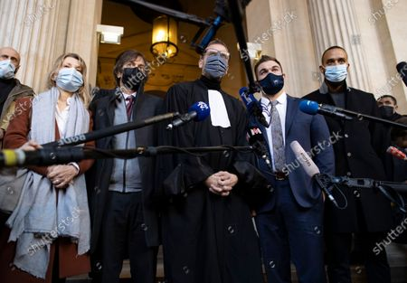 Passenger who was wounded in the 2015 Thalys train attack, Mark Moogalian (2-L) and his wife Isabelle (L), US citizens Alek Skarlatos (2-R) and Anthony Sadler (R) and French lawyer Thibault de Montbrial (C) leave the court room and hold a news conference during the fifth day of the Thalys attack trial, in Paris, France, 20 November 2020. On 21 August 2015, gunman Ayoub El-Khazzani opened fire with an assault rifle, shot and wounded three people on a Thalys train travelling between Amsterdam and Paris before the assailant was overpowered by passengers.The incident happened near Arras in northern France shortly after 1600 GMT and the gunman was arrested when the train stopped at the town's station.