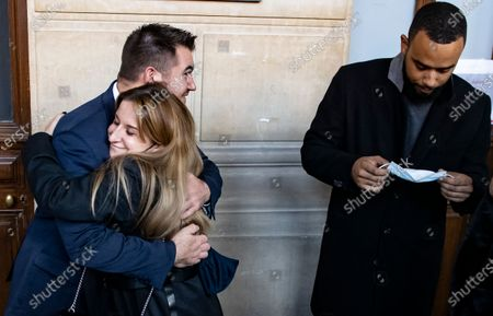 A Thalys train employee hugs US citizens Alek Skarlatos, as Anthony Sadler puts on his face masks, outside the court room during the fifth day of the Thalys attack trial, in Paris, France, 20 November 2020. On 21 August 2015, gunman Ayoub El-Khazzani opened fire with an assault rifle, shot and wounded three people on a Thalys train travelling between Amsterdam and Paris before the assailant was overpowered by passengers.The incident happened near Arras in northern France shortly after 1600 GMT and the gunman was arrested when the train stopped at the town's station.