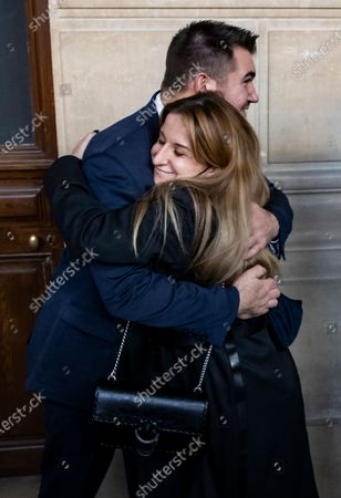 A Thalys train employee hugs US citizens Alek Skarlatos as he leave the court room during the fifth day of the Thalys attack trial, in Paris, France, 20 November 2020. On 21 August 2015, gunman Ayoub El-Khazzani opened fire with an assault rifle, shot and wounded three people on a Thalys train travelling between Amsterdam and Paris before the assailant was overpowered by passengers.The incident happened near Arras in northern France shortly after 1600 GMT and the gunman was arrested when the train stopped at the town's station.