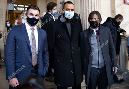 Passenger who was wounded in the 2015 Thalys train attack, Mark Moogalian (R) , US citizens Alek Skarlatos (L) and Anthony Sadler (C) pose as they leave the court room and hold a news conference during the fifth day of the Thalys attack trial, in Paris, France, 20 November 2020. On 21 August 2015, gunman Ayoub El-Khazzani opened fire with an assault rifle, shot and wounded three people on a Thalys train travelling between Amsterdam and Paris before the assailant was overpowered by passengers.The incident happened near Arras in northern France shortly after 1600 GMT and the gunman was arrested when the train stopped at the town's station.