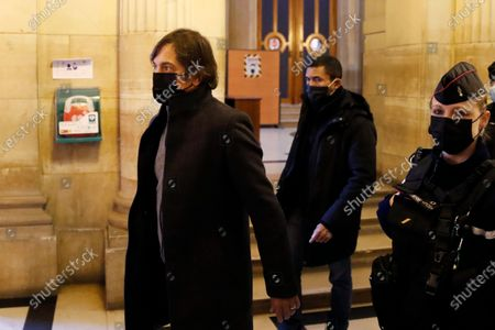 French-American Mark Moogalian, left, arrives for the Thalys attack trial at the Paris courthouse, . Passengers who wrestled and disarmed an Islamic State gunman aboard a high-speed Amsterdam to Paris train are recounting how their split-second decisions helped prevent what could have become a mass slaughter. AP Photo/Francois Mori