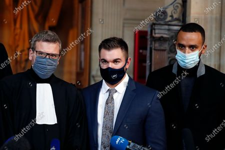 Alek Skarlatos, center, Anthony Sadler, right, and their lawyer Thibault de Montbrial, left, talk to the press during the Thalys attack trial at the Paris courthouse, . Passengers who wrestled and disarmed an Islamic State gunman aboard a high-speed Amsterdam to Paris train are recounting how their split-second decisions helped prevent what could have become a mass slaughter. AP Photo/Francois Mori