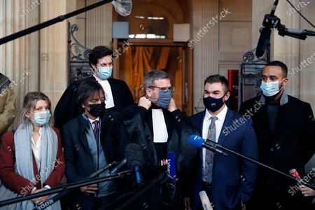 Alek Skarlatos, center right, Anthony Sadler, right, Mark Moogalian, second from left, his wife Isabelle, left, and their lawyer Thibault de Montbrial, center, arrive to deliver a speech during the Thalys attack trial at the Paris courthouse, . Passengers who wrestled and disarmed an Islamic State gunman aboard a high-speed Amsterdam to Paris train are recounting how their split-second decisions helped prevent what could have become a mass slaughter. AP Photo/Francois Mori