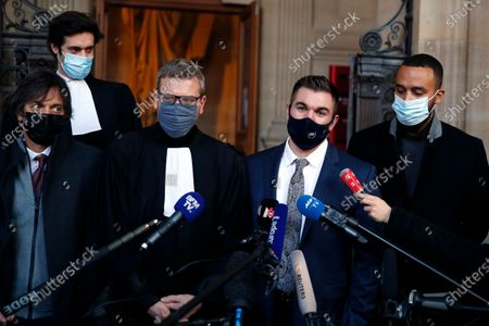 Alek Skarlatos, center right, Anthony Sadler, right, Mark Moogalian, left, and their lawyer Thibault de Montbrial, center left, deliver a speech during the Thalys attack trial at the Paris courthouse, . Passengers who wrestled and disarmed an Islamic State gunman aboard a high-speed Amsterdam to Paris train are recounting how their split-second decisions helped prevent what could have become a mass slaughter. AP Photo/Francois Mori