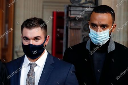 Alek Skarlatos, left, and Anthony Sadler, right, arrive to deliver a speech during the Thalys attack trial at the Paris courthouse, . Passengers who wrestled and disarmed an Islamic State gunman aboard a high-speed Amsterdam to Paris train are recounting how their split-second decisions helped prevent what could have become a mass slaughter. AP Photo/Francois Mori