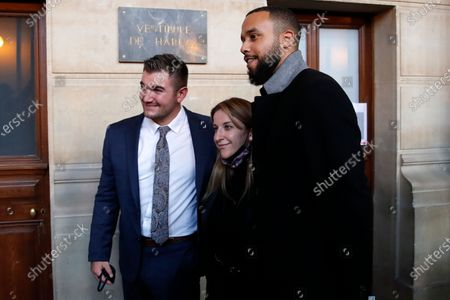 Alek Skarlatos, left, Anthony Sadler, right, and train host Shauna Asley Verstichelen, pose for photographers during the Thalys attack trial at the Paris courthouse, . Passengers who wrestled and disarmed an Islamic State gunman aboard a high-speed Amsterdam to Paris train are recounting how their split-second decisions helped prevent what could have become a mass slaughter