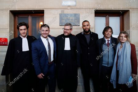 From left, lawyer Louis Cailliez, Alek Skarlatos, lawyer Thibault de Montbrial, Anthony Sadler, Mark Moogalian and Isabelle Risacher Moogalian, pose at the end of their hearing during the Thalys attack trial at the Paris courthouse, . Passengers who wrestled and disarmed an Islamic State gunman aboard a high-speed Amsterdam to Paris train are recounting how their split-second decisions helped prevent what could have become a mass slaughter. AP Photo/Francois Mori