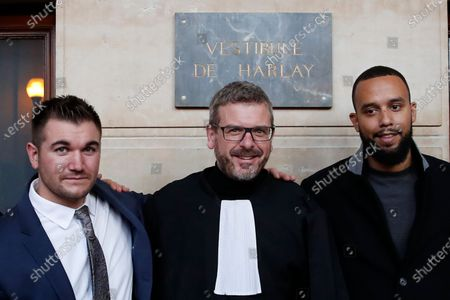 Alek Skarlatos, left, Anthony Sadler, right, and their lawyer Thibault de Montbrial, pose for photographers at the end of their hearing during the Thalys attack trial at the Paris courthouse, . Passengers who wrestled and disarmed an Islamic State gunman aboard a high-speed Amsterdam to Paris train are recounting how their split-second decisions helped prevent what could have become a mass slaughter