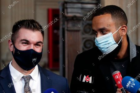 Alek Skarlatos, left, and Anthony Sadler, right, deliver a speech during the Thalys attack trial at the Paris courthouse, . Passengers who wrestled and disarmed an Islamic State gunman aboard a high-speed Amsterdam to Paris train are recounting how their split-second decisions helped prevent what could have become a mass slaughter