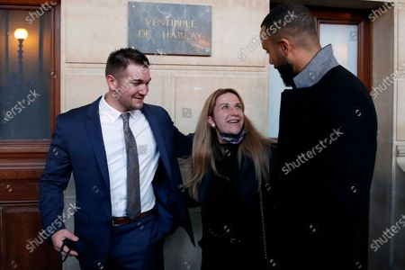 Train host Shauna Asley Verstichelen, center, greets Alek Skarlatos, left, and Anthony Sadler, right, at the end of their hearing during the Thalys attack trial at the Paris courthouse, . Passengers who wrestled and disarmed an Islamic State gunman aboard a high-speed Amsterdam to Paris train are recounting how their split-second decisions helped prevent what could have become a mass slaughter