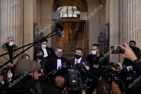 Alek Skarlatos, center right, Anthony Sadler, right, Mark Moogalian, left, and their lawyer Thibault de Montbrial, center left, deliver a speech during the Thalys attack trial at the Paris courthouse, . Passengers who wrestled and disarmed an Islamic State gunman aboard a high-speed Amsterdam to Paris train are recounting how their split-second decisions helped prevent what could have become a mass slaughter. AP Photo/Thibault Camus