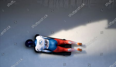 Stock Picture of Alena Frolova of Russia speeds down the track during her first run of the women's Skeleton World Cup race in Sigulda, Latvia