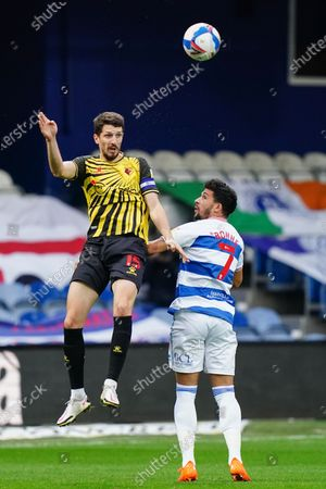 Craig Cathcart of Watford heads the ball over Macauley Bonne of QPR