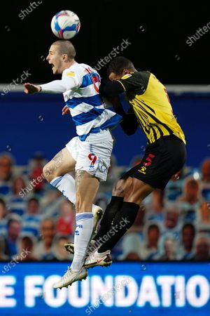Stock Image of Lyndon Dykes of QPR wins an aerial challenge over William Troost-Ekong of Watford