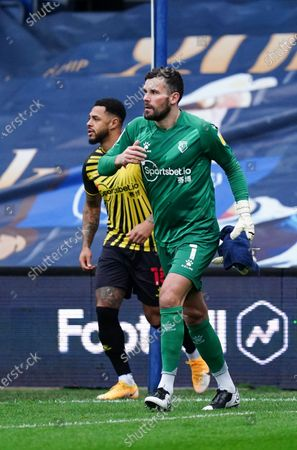 Ben Foster of Watford and the Watford team run out on to the pitch