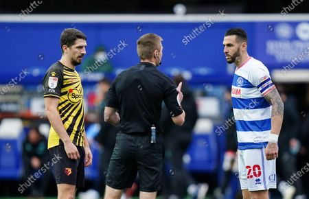 Craig Cathcart of Watford and Geoff Cameron of QPR with referee Michael Salisbury for the coin toss before kick-off