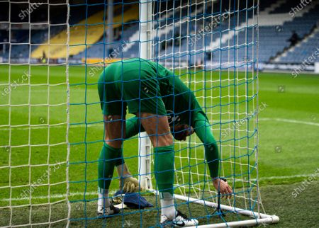 Ben Foster goalkeeper of Watford sets up his own camera in the goal net