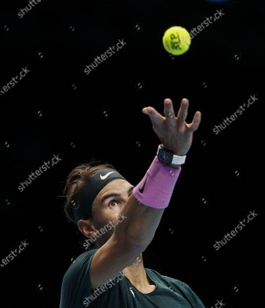 Rafael Nadal of Spain serves during the singles group match against Stefanos Tsitsipas of Greece at the ATP World Tour Finals 2020 in London, Britain, on Nov. 19, 2020.