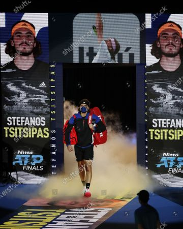 Stefanos Tsitsipas of Greece enters the court before the singles group match against Rafael Nadal of Spain at the ATP World Tour Finals 2020 in London, Britain, on Nov. 19, 2020.