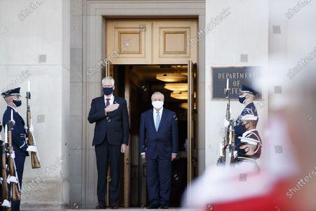 U.S. Acting Secretary of Defense Christopher Miller (C-L) welcomes Uzbek Foreign Minister Abdulaziz Kamilov (C-R) at the Pentagon in Arlington, Virginia, the United States, on Nov. 19, 2020.