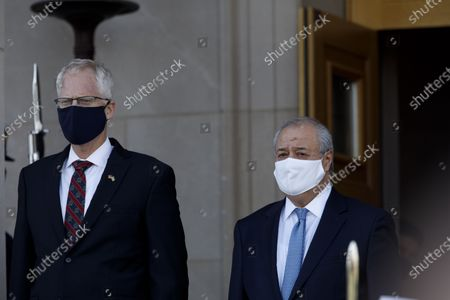 U.S. Acting Secretary of Defense Christopher Miller (L) welcomes Uzbek Foreign Minister Abdulaziz Kamilov at the Pentagon in Arlington, Virginia, the United States, on Nov. 19, 2020.