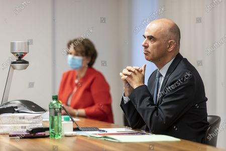 Federal Councillor Alain Berset (R), Swiss minister of home affairs, next to Sylvie Durrer, director of the Federal Office for the Equality of women and men EBG, participates in an informal meeting of EU Gender Equality Ministers, in Bern, Switzerland, 20 November 2020. The meeting takes place by video transmission due to the Coronavirus, Covid-19 pandemic.