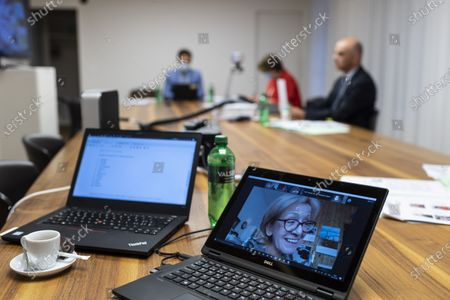 Federal Councillor Alain Berset, Swiss minister of home affairs, right, participates in an informal meeting of EU Gender Equality Ministers, as the Czech State Secretary Helena Valkova, on screen, speaks, in Bern, Switzerland, 20 November 2020. The meeting takes place by video transmission due to the Coronavirus, Covid-19 pandemic.