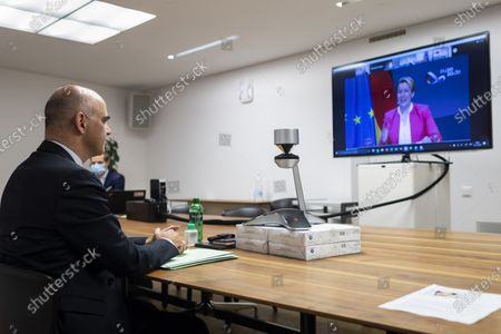 Federal Councillor Alain Berset, Swiss minister of home affairs, left, speaks to Franziska Giffey, German Federal minister for Family Affairs, on screen, during an informal meeting of EU Gender Equality Ministers speaks, in Bern, Switzerland, 20 November 2020. The meeting takes place by video transmission due to the Coronavirus, Covid-19 pandemic.