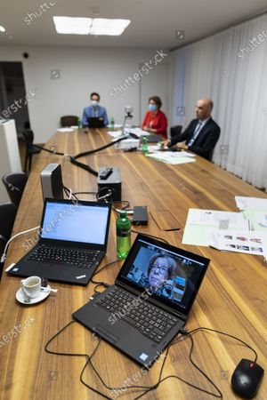 Federal Councillor Alain Berset, Swiss minister of home affairs (R) participates in an informal meeting of EU Gender Equality Ministers, as the Czech State Secretary Helena Valkova, front on screen, speaks, in Bern, Switzerland, 20 November 2020. The meeting takes place by video transmission due to the Coronavirus, Covid-19 pandemic.