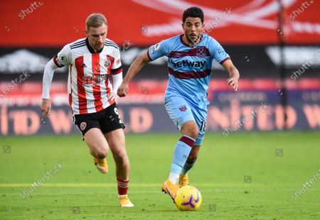 Pablo Fornals of West Ham United and Oli McBurnie of Sheffield United