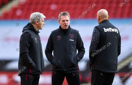 Stuart Pearce first team coach (centre)