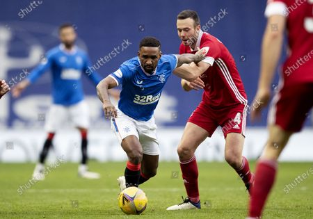 Jermain Defoe of Rangers and Andrew Considine of Aberdeen.