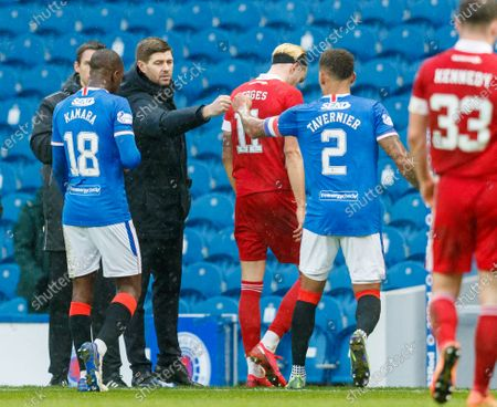 Rangers Manager Steven Gerrard & Rangers Captain James Tavernier bump fists at full-time