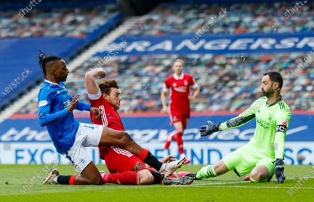 Joe Aribo of Rangers challenges for the ball with Ashton Taylor of Aberdeen & Aberdeen goalkeeper Joe Lewis