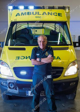Picture shows paramedic photographer Chris Porsz. A paramedic has spent more than 40 years photographing the changing face of the NHS - and published his pictures in a new book. Amateur photographer Chris Porsz, 67, spent many of his days off over the last four decades accompanying colleagues to capture the patient's journey from the 999 call to the hospital. He has taken hundreds of pictures of doctors, nurses, patients and wards at three hospitals in Peterborough, Cambridgeshire and now produced a book, Just Be Kind, with part proceeds going to Breast Cancer Research.Chris took dozens of photos over the years, whilst working as a porter and later a paramedic, and his pictures offer a unique behind-the-scenes view of the NHS from the 1980s, with nurses neatly dressed in blue gingham and frilly hats, to the present with masked doctors dealing with the coronavirus pandemic.