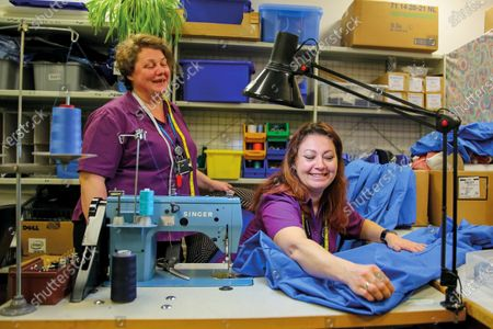 Sewing room at Peterborough City Hospital September 2015. A paramedic has spent more than 40 years photographing the changing face of the NHS - and published his pictures in a new book. Amateur photographer Chris Porsz, 67, spent many of his days off over the last four decades accompanying colleagues to capture the patient's journey from the 999 call to the hospital. He has taken hundreds of pictures of doctors, nurses, patients and wards at three hospitals in Peterborough, Cambridgeshire and now produced a book, Just Be Kind, with part proceeds going to Breast Cancer Research.Chris took dozens of photos over the years, whilst working as a porter and later a paramedic, and his pictures offer a unique behind-the-scenes view of the NHS from the 1980s, with nurses neatly dressed in blue gingham and frilly hats, to the present with masked doctors dealing with the coronavirus pandemic.