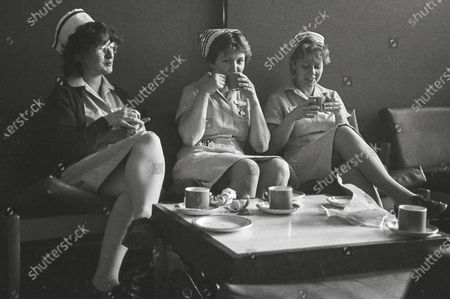 Nurses relaxing in 1984. A paramedic has spent more than 40 years photographing the changing face of the NHS - and published his pictures in a new book. Amateur photographer Chris Porsz, 67, spent many of his days off over the last four decades accompanying colleagues to capture the patient's journey from the 999 call to the hospital. He has taken hundreds of pictures of doctors, nurses, patients and wards at three hospitals in Peterborough, Cambridgeshire and now produced a book, Just Be Kind, with part proceeds going to Breast Cancer Research.Chris took dozens of photos over the years, whilst working as a porter and later a paramedic, and his pictures offer a unique behind-the-scenes view of the NHS from the 1980s, with nurses neatly dressed in blue gingham and frilly hats, to the present with masked doctors dealing with the coronavirus pandemic.
