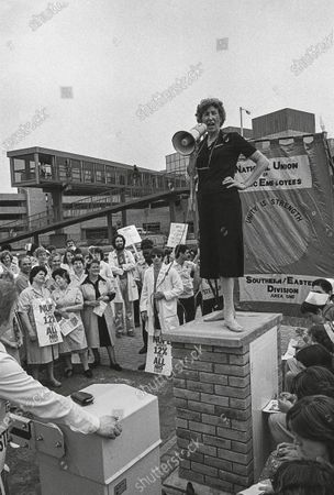 Theatre Sister Ruth Cunnington taking part in the national campaign against low pay, 1982. A paramedic has spent more than 40 years photographing the changing face of the NHS - and published his pictures in a new book. Amateur photographer Chris Porsz, 67, spent many of his days off over the last four decades accompanying colleagues to capture the patient's journey from the 999 call to the hospital. He has taken hundreds of pictures of doctors, nurses, patients and wards at three hospitals in Peterborough, Cambridgeshire and now produced a book, Just Be Kind, with part proceeds going to Breast Cancer Research.Chris took dozens of photos over the years, whilst working as a porter and later a paramedic, and his pictures offer a unique behind-the-scenes view of the NHS from the 1980s, with nurses neatly dressed in blue gingham and frilly hats, to the present with masked doctors dealing with the coronavirus pandemic.