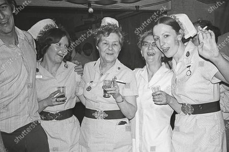 Hospital social club. Mick Reeves, Maggie Sayer in middle, and Angie Owen end right, 1980. A paramedic has spent more than 40 years photographing the changing face of the NHS - and published his pictures in a new book. Amateur photographer Chris Porsz, 67, spent many of his days off over the last four decades accompanying colleagues to capture the patient's journey from the 999 call to the hospital. He has taken hundreds of pictures of doctors, nurses, patients and wards at three hospitals in Peterborough, Cambridgeshire and now produced a book, Just Be Kind, with part proceeds going to Breast Cancer Research.Chris took dozens of photos over the years, whilst working as a porter and later a paramedic, and his pictures offer a unique behind-the-scenes view of the NHS from the 1980s, with nurses neatly dressed in blue gingham and frilly hats, to the present with masked doctors dealing with the coronavirus pandemic.