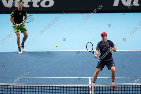 Stock Image of John Peers of Australia, right, and Michael Venus of New Zealand, left, play a return during their doubles tennis match against Mate Pavic of Croatia and Bruno Soares of Brazil at the ATP World Finals tennis tournament at the O2 arena in London